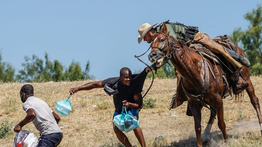 Border Patrol Agents Seem to Use Horse Reins As Whips Against Haitians